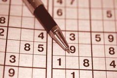 Game Sudoku and ballpoint pen. On the table royalty free stock images