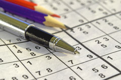 Game Sudoku and colored pencils. On the table royalty free stock photos