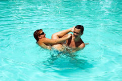 Game in swimming pool Stock Image