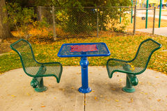 Game Table at Local Park in Fall Stock Photo