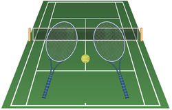 A game of tennis. Green tennis court with netting, two tennis rackets and one ball Stock Photo