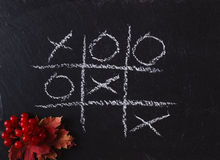 Game Tic Tac Toe on black slate board Royalty Free Stock Image