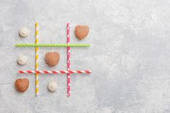 Game TIC TAC toe. Love wins. Saint Valentines Day conception. Top view, flat lay Stock Photos