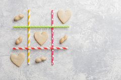 Game TIC TAC toe. Love wins. Saint Valentines Day conception. Top view, flat lay Royalty Free Stock Images