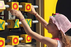 Game Tic Tac Toe. Tic tac toe on the playground. little girl playing in the game Stock Image