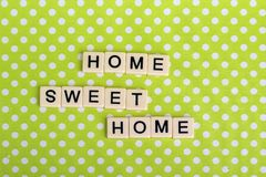 Game tiles forming family concept phrase. Home and family related sentence formed with game tile letters stock images