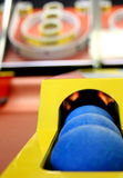 Game time. Closeup of balls from a skeeball carnival arcade game Royalty Free Stock Photos
