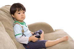 Game time. Young Asian boy playing video games stock photos