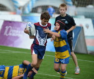 Game time in the match the children`s Rugby tournament. Stock Photo