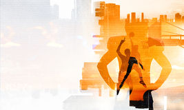 It is game time. Mixed media. Silhouettes of basketball players on modern city backgound. Mixed media Royalty Free Stock Photos