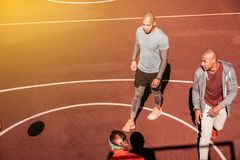 Top view of nice young men walking. During the game. Top view of nice young men walking on the basketball court while playing the game royalty free stock photos