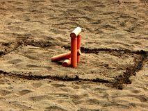 Game Towns. The figure is called a machine-gun nest. The figure on the sand stick to the game of towns. The figure is called the Machine gun nest stock photography