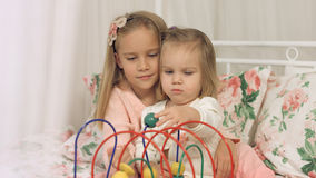 Game of two sisters with interesting educational toy Stock Photography