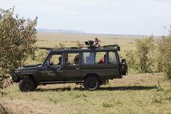 Game viewing vehicle and wildlife photographer Royalty Free Stock Image