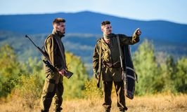 Gamekeeper rifles nature environment. Gamekeepers walk mountains background. Gamekeepers sunny fall day. Gamekeeper. Occupation concept. Hunting with partner stock image