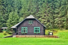 Gamekeepers house in a forest open-air museum in Vydrovo. Forest, nature, trees and grass Stock Photo