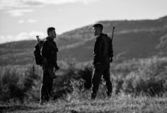 Gamekeepers walk mountains background. Gamekeeper occupation concept. Gamekeepers sunny fall day. Hunting with partner. Provide greater safety fun and rewarding stock photos