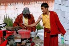 Gamel, China: Tibetan Monks and Tractor Royalty Free Stock Photography
