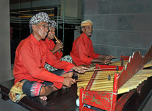 Gamelan Jegog Trio Performing in Bali, Indonesia. Stock Images