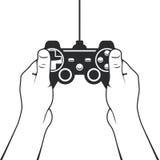 Gamepad dans l'icône de mains - contrôleur de console de jeu Photographie stock