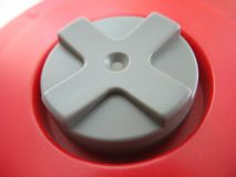 Gamepad detail. The d-pad of a red video game controller Royalty Free Stock Photography
