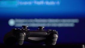 Gamepad e console del gioco video d archivio