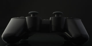 Gamepad. Extreme close up of a gamepad from back on black background with reflection Royalty Free Stock Image