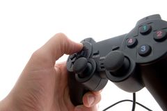 Gamepad in the hand. Black gamepad in the hand on a white background Stock Photos