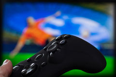 Gamepad in hand Stock Photography