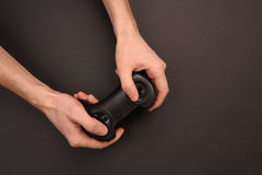 Gamepad in hands. Royalty Free Stock Image