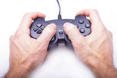 Gamepad i händer Arkivfoto