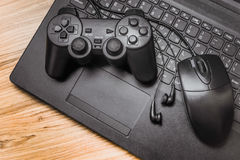 Gamepad on the laptop Stock Image