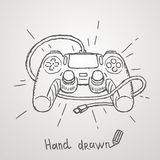 Gamepad tiré par la main Illustration de vecteur Image stock