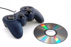 Gamepad y CD Foto de archivo libre de regalías
