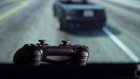 Gamepad y videoconsola almacen de metraje de vídeo