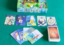 Gameplay in Dixit board game on green baize table. MOSCOW, RUSSIA - APRIL 3, 2019: top view of gameplay in Dixit board game on green baize table. Dixit is a card stock photos