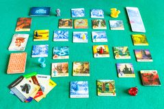 Gameplay of Forbidden Island board game. MOSCOW, RUSSIA - APRIL 3, 2019: gameplay of Forbidden Island cooperative board game russian edition. The game was royalty free stock image