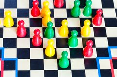 Gameplay of Halma strategy board game close up. Halma board game was invented by George Howard Monks in1883-1884 royalty free stock image