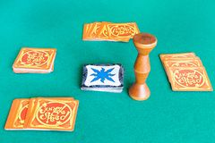 Gameplay of Jungle Speed board game on green table. MOSCOW, RUSSIA - APRIL 2, 2019: gameplay of Jungle Speed board game on green baize table. Jungle Speed is a royalty free stock image