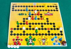 Gameplay of Malefiz strategy board game. MOSCOW, RUSSIA - APRIL 2, 2019: gameplay of Malefiz  Barricade strategy board game on green baize table. The game was royalty free stock photography