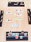 Gameplay of Rummikub board game Royalty Free Stock Photo