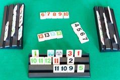 Gameplay of Rummikub tile-based game on table. MOSCOW, RUSSIA - APRIL 3, 2019: gameplay of Rummikub tile-based game on green baize table. Rummikub was invented stock photos