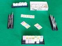 Gameplay of Rummy tile-based card game on table. MOSCOW, RUSSIA - APRIL 3, 2019: gameplay of Rummy tile-based card game on green baize table. Rummy is tile and royalty free stock photography
