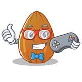 Gamer almond nut character cartoon Stock Photos