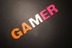 Gamer. Big color letters on black background text illustration message pedryj type graphic creative stock images