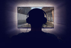 Gamer in front of a blank monitor Royalty Free Stock Photography