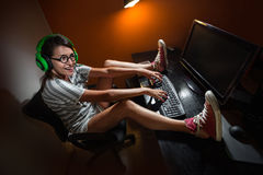 Gamer girl playing  with computer Stock Photo