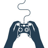 Gamer holding in hand gamepad Stock Images