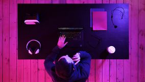 Gamer making a call. Top view.Gamer making a call. Professional shot in 4K resolution. 020. You can use it e.g. in your commercial video, medical, business royalty free stock image