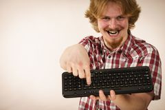 Gamer man holding computer keyboard Stock Photography